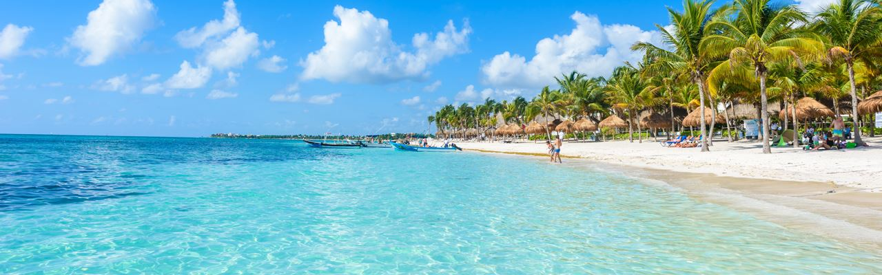 People Enjoying In A Beautiful Sunny Tropical Beach Dominican Republic