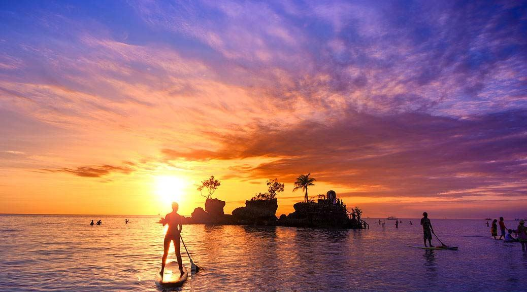 Colourful Kuta Beach With Paddle Boarders And Tiny Island Bali Holidays